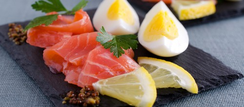 smoked salmon and eggs on slate palte