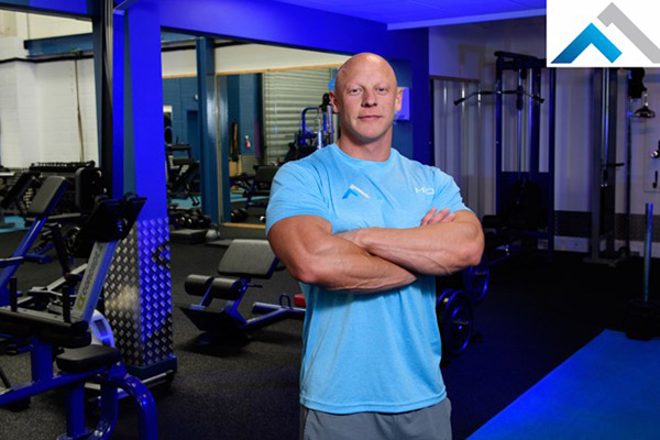 craig barton personal trainier standing in frontier gym