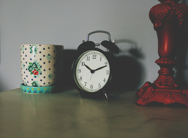 alarm clock and candle